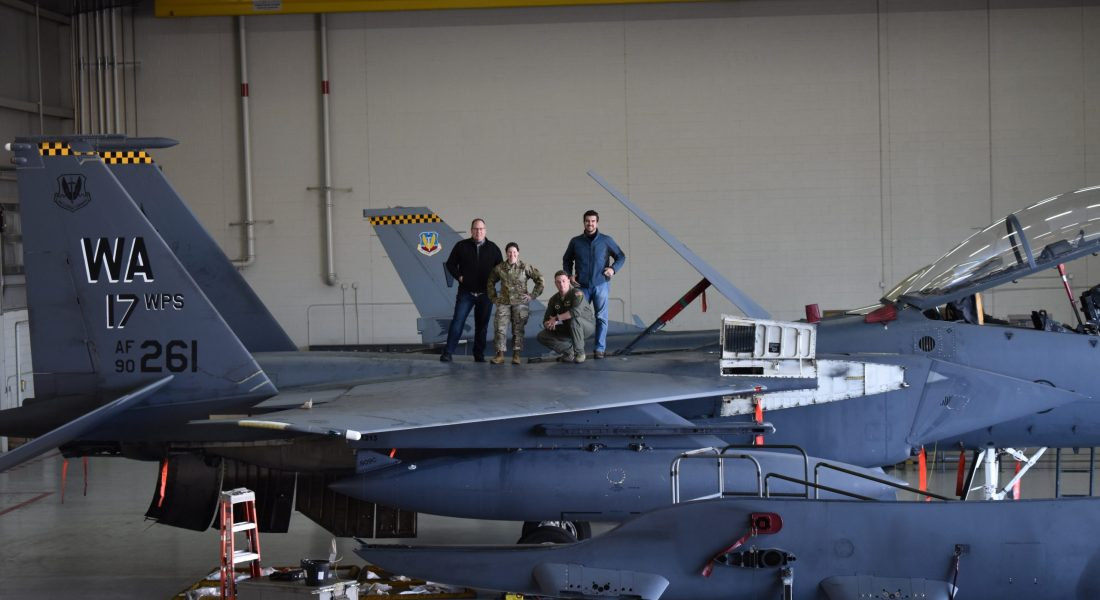 MVI team on top of exterior portion of aircraft